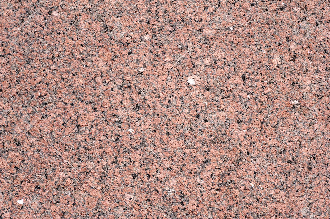 Texture of old wall of polished pink granite